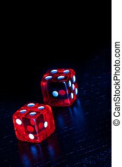 red dice on old wood black table with space for text - red...