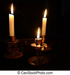 3 Lit Candles in the Dark on Table - 3 Lit Candles with...