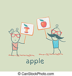 girl and boy holding posters with apples