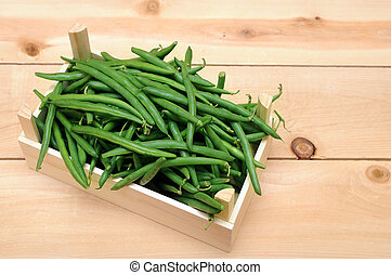 green beans - a lot og green beans in wooden case