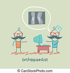 orthopaedist tells the patient about an x-ray