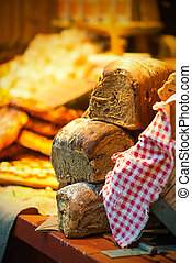 Bread on display at a outdoor market - Bread on display at a...