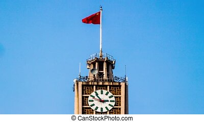 The clock tower and the flag in Beijing,China
