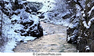 winter scene - flowing river in winter
