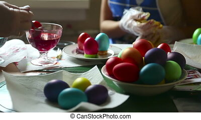 Coloring easter eggs - Two women coloring easter eggs.