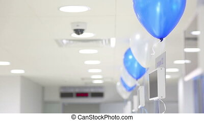 Swaying balloons - Blue and white balloons swaying on cords...
