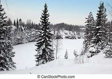 Winter snowfall in old marble quarry, Karelia, Russia