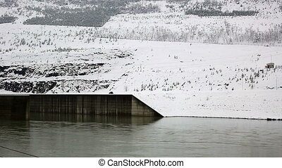 power plant - hydroelectric power plant in winter, pan shoot