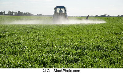 tractor spray insecticide - Tractor spray fertilize field...
