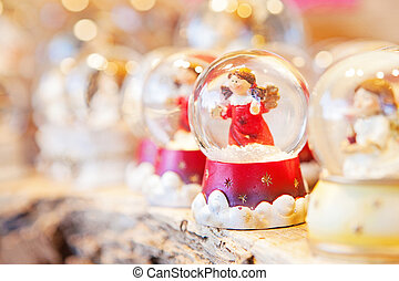 Christmas Angel Snow Globe - A row of Christmas snow globes...