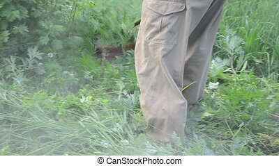 man trimmer cut grass - Turn view man worker with trimmer...