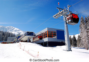 The cableway station at popular ski resort and slope