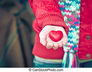Heart shape love symbol in woman hands Valentines Day...
