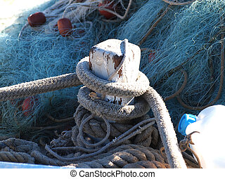 fishing boat - ropes and net on wooden fishing boat
