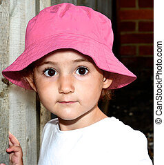 Young child, girl in pink hat outside