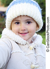 Young smiling child outdoors