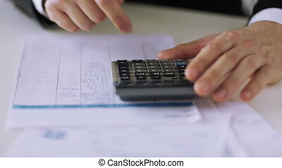 man with calculator filling a form - business, tax, office,...
