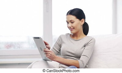 smiling student girl or woman with tablet pc - education,...