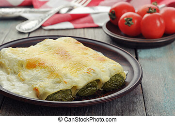 Italian cannelloni stuffed with spinach and ricotta with...