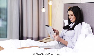 businesswoman working with tablet pc computer in hotel -...