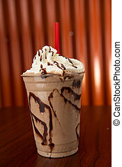 Chocolate Milkshake - Chocolate milkshake in a plastic cup,...