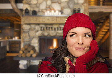Mixed Race Girl Enjoying Warm Fireplace In Rustic Cabin