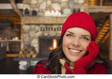 Mixed Race Girl Enjoying Warm Fireplace In Rustic Cabin -...