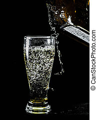 glass pouring drink on black - pouring drink on black.Shot...