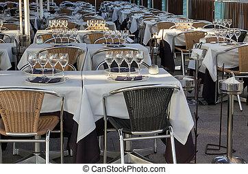 restaurant tables set for meal