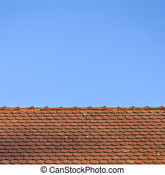 roof with red tiles under blue sky
