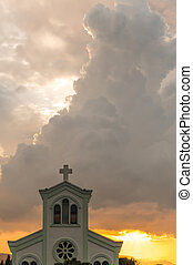 Classical church with sunset and orange clouds background