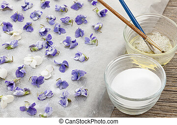 Making candied violets - Making candied violet flowers with...