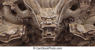 stone dragon and Chinese architecture on temple