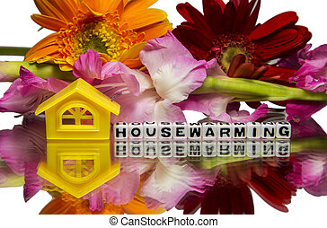 Housewarming - House warming message with home and flowers.