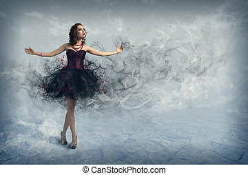 woman dancing - Young woman dancing for her abstract...