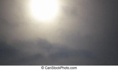 Sun in clouds mist