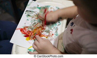 Boy painting. - Little boy painting with colorful...