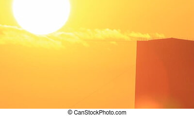 Sun at sky on silhouette building - Sun disk travel at...