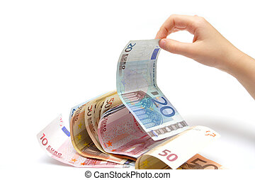 pinching a money - child`s hand pinching a euro banknotes...