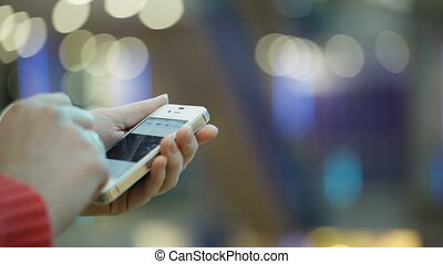 Using smartphone. - Close-up of female hands flipping...