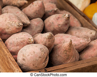 yam - Sweet potatoes, yam in a wooden box