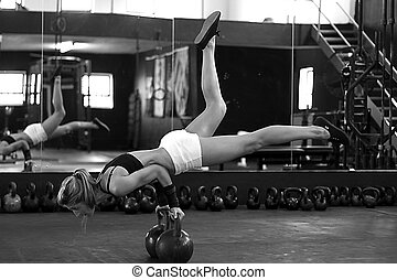 Black and white strength training - Model working out in gym