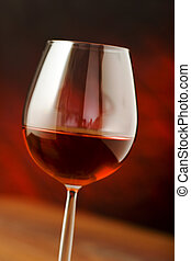 red wine glass over a dark background