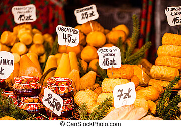 Traditional polish smoked cheese oscypek on outdoor market...