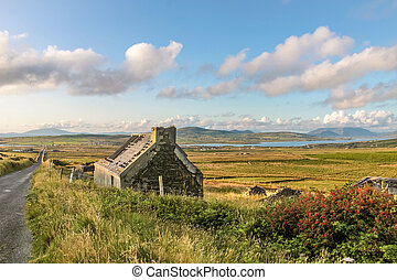 Pasture landscape and ruin near Portmagee, County Kerry,...