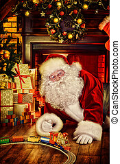 happy childhood - Santa Claus playing with toys under the...