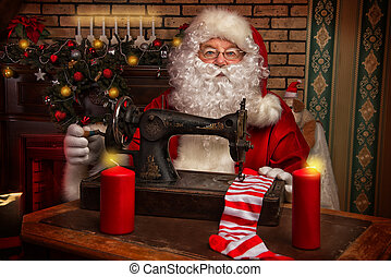 industrious - Santa Claus is sewing on a sewing machine...