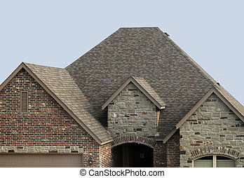 New Roof Job - House with a new shingle roof and roof vent