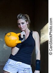 Kettlebells at the water tower - Model using bodyweight and...