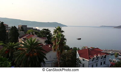 Herceg Novi, port for ships, panorama of the city, pan left